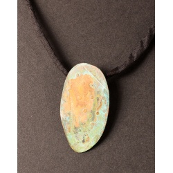 Textured copper oval with green patina